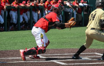 Junior Nick Cieri reaches to tag a Purdue player out 4/24/26 Hannah Evans/Maryland Baseball Network