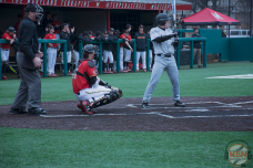 Senior Justin Morris crouches behind the plate. Photo by Amanda Broderick/Maryland Baseball Network