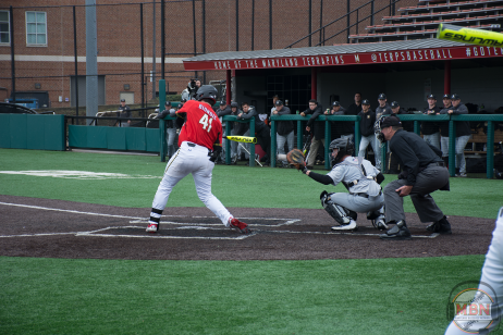 Kevin Biondic hits a leadoff triple in the fourth inning against Army on 2/25/18. Photo by Amanda Broderick/Maryland Baseball Network
