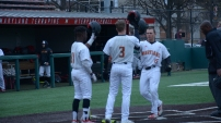 Chris Alleyne and Zach Jancarski congratulate Randy Bendar on another home run. Photo by Amanda Broderick/Maryland Baseball Network