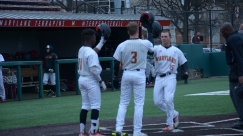 Chris Alleyne and Zach Jancarski congratulate Randy Bendar on another home run. Photo by Amanda Broderick/Maryland Baseball Network