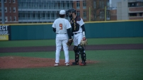 Billy Phillips and Justin Vought discuss their strategy. Photo by Amanda Broderick/Maryland Baseball Network