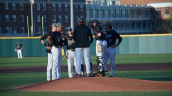 Maryland baseball players gather on the mound. Photo by Amanda Broderick/Maryland Baseball Network