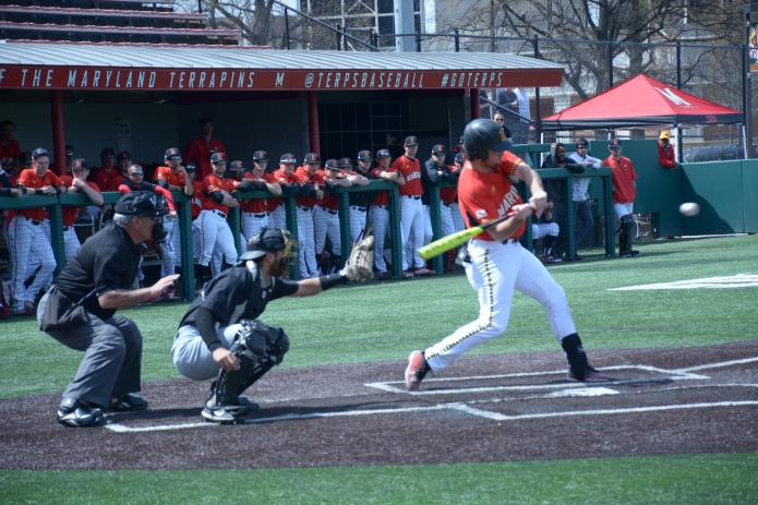 First baseman Kevin Biodic mid swing. Photo by Amanda Broderick/Maryland Baseball Network