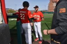 Taylor Wright receives guidance from a coach. Photo by Amanda Broderick/Maryland Baseball Network