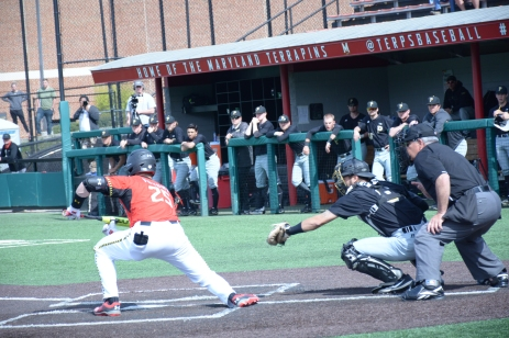 Catcher Justin Vought bunts. Photo by Amanda Broderick/Maryland Baseball Network