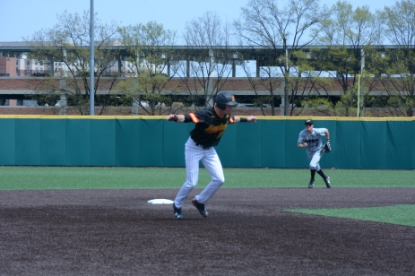 Taylor Wright leaps to avoid an incoming grounder. Photo by Amanda Broderick/Maryland Baseball Network