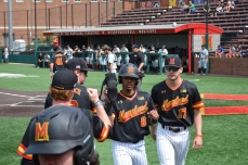 The team congratulates AJ Lee on scoring a run. Photo by Amanda Broderick/Maryland Baseball Network