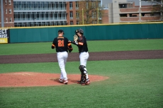 Pitcher Tyler Blohm and catcher Justin Morris talk on the mound. Photo by Amanda Broderick/Maryland Baseball Network